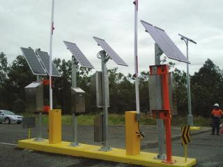 Solar powered boom gate